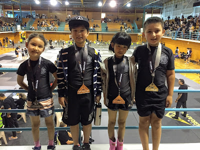 Auckland BJJ Kids wearing the medals they won at a competition