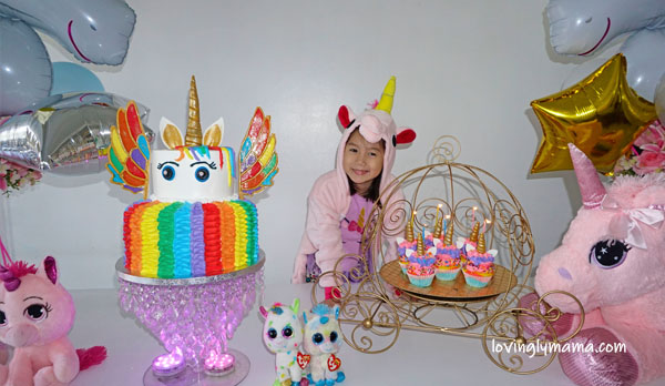 unicorn girl - unicorn onesies- unicorn cake - rainbow unicorn cake - unicorn cupcakes - 6th birthday pictorial - Bacolod Cupcake Cafe - unicorn foil balloons - Bacolod mommy blogger - birthday party - unicorn cake - unicorn cupcakes - birthday candles