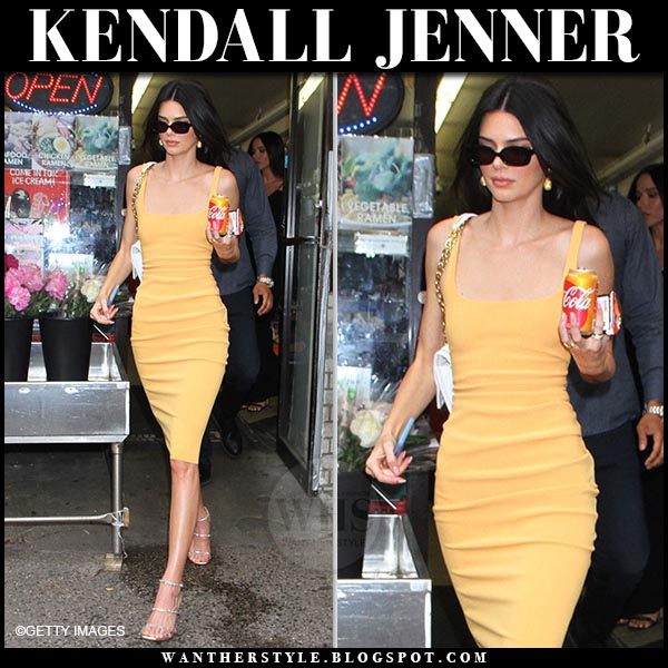 Kendall Jenner in yellow fitted midi dress from bec and bridge and amina muaddi sandals. Celebrity summer outfit june 17