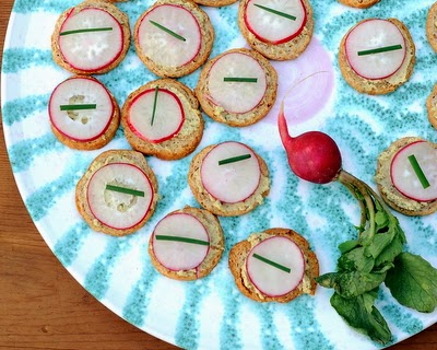 Fall in love with summer's best radishes! Just thin slices atop something creamy like Boursin and salty like Melba toast. Easy appetizer!