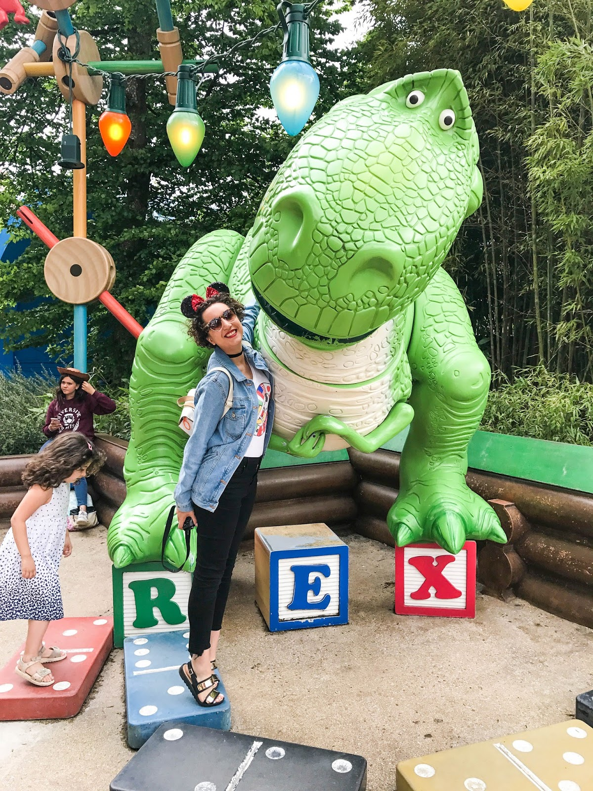 Fashion blogger hugging Rex from Toy Story at Disneyland Paris