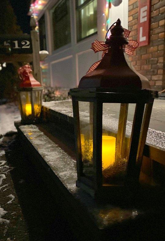 Christmas lanterns on a snowy stoop