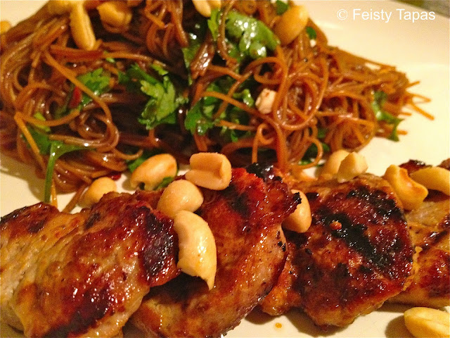 Noodle salad with pork: pork, rice noodles, coriander, soy sauce, honey, peanuts, lime