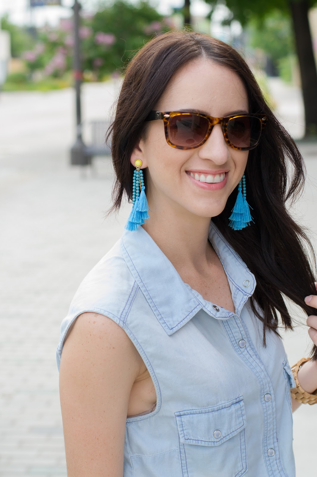 Styling colorful tassel earrings with chambray and white