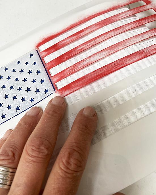 stenciling stars onto a flag