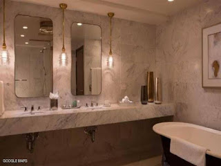 """أمريكية تقاضي شركة فنادق """"هيلتون""""، بعد تصويرها أثناء الاستحمام... وتطلب 100 مليون دولار تعويض"""