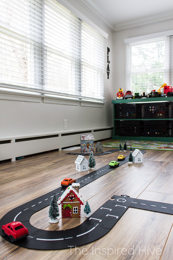 Flexible toy roads set up as Christmas village