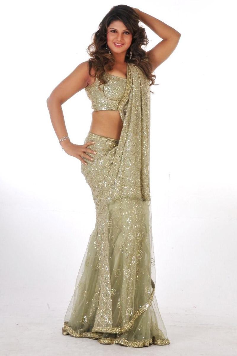 Actress Rambha Long Hair Stills In Green Half Saree