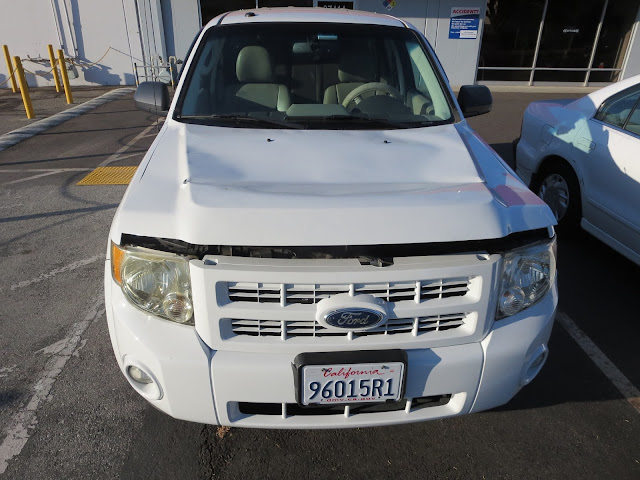 Hood flew open on 2011 Ford Escape Hybrid prior.