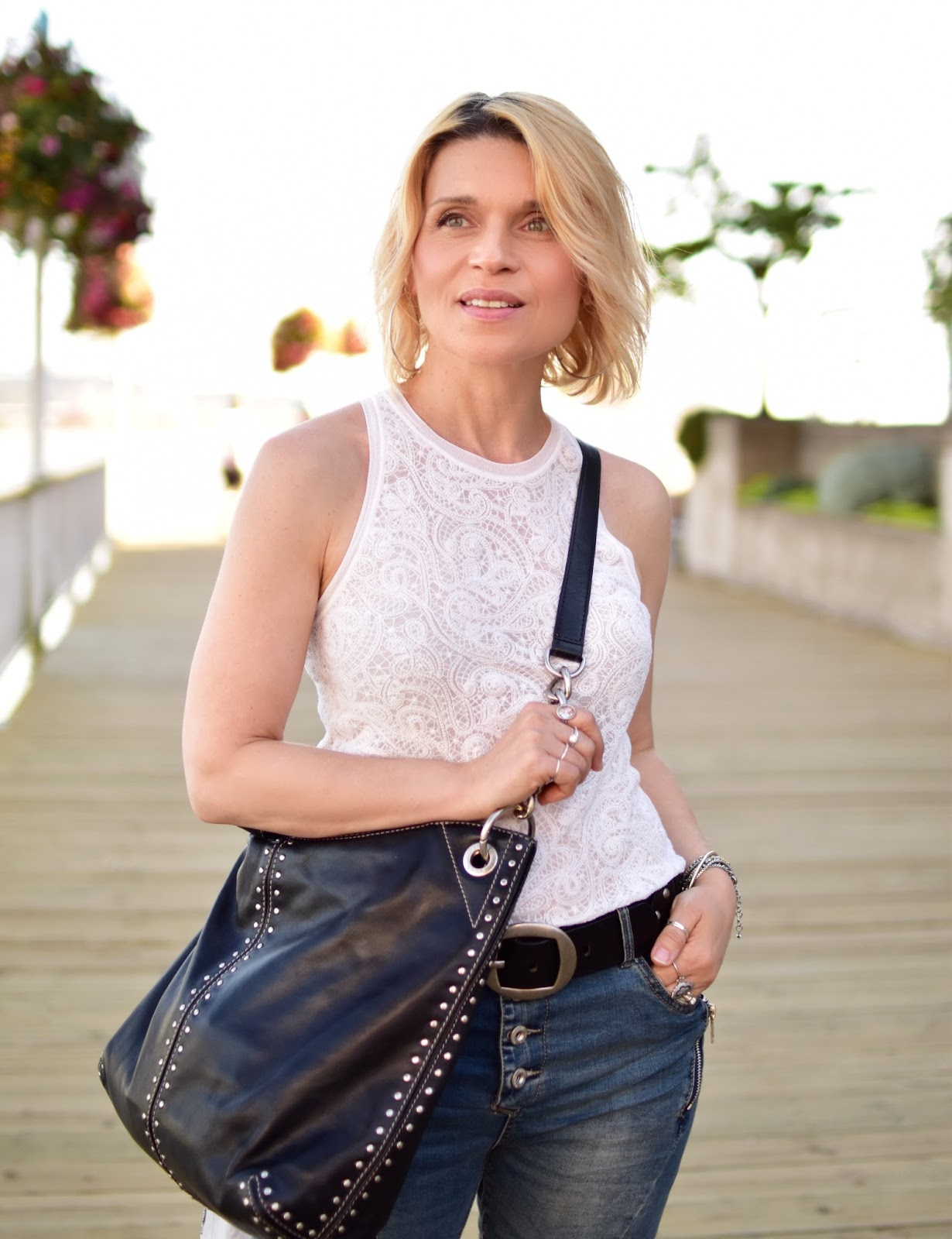 Aritzia lacy tank top, Michael Kors stud-embellished bag