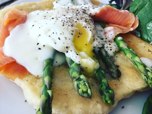 Poached egg on Asparagus with white sauce.
