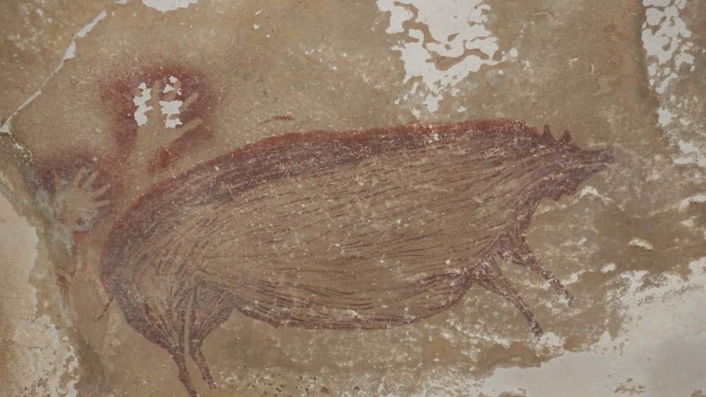 pintura de un cerdo en la pared