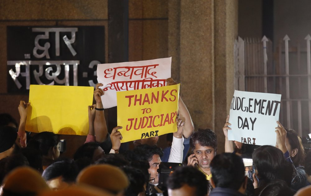 Indians Hold Banners Thanking Judiciary