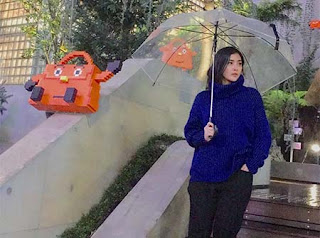 Eva Anindita Bawa Payung