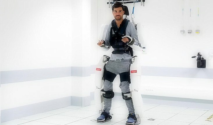 A paralyzed person walks in a brain-controlled robotic suit