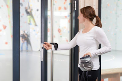 Innovative forearm shield effortlessly converts push/pull doors to hands-free for COVID-19 prevention