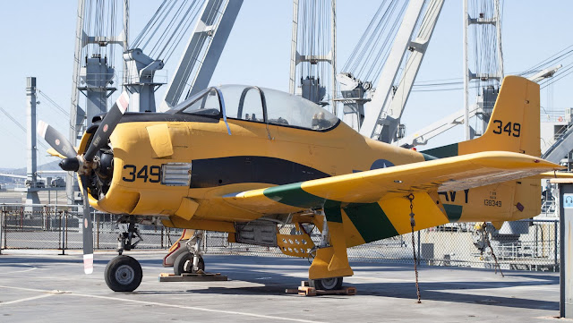 Yellow plane on the deck of the USS Hornet in Alameda, California