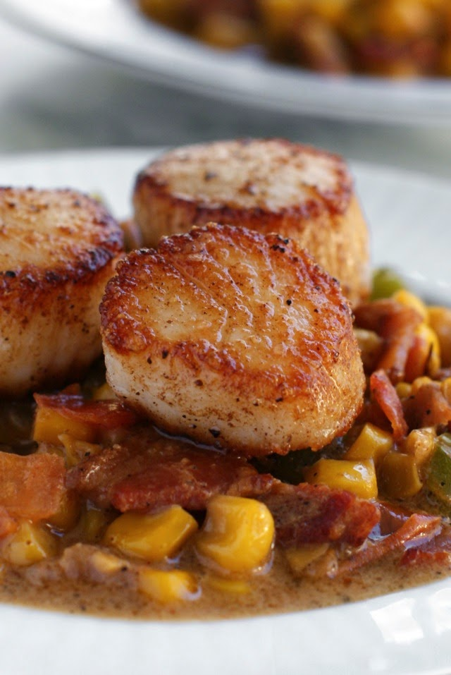 Seared Scallops with Creamy Bacon Corn Sauce is a cajun-seasoned dish that is super simple to prepare, yet boasts a perfectly elegant presentation.