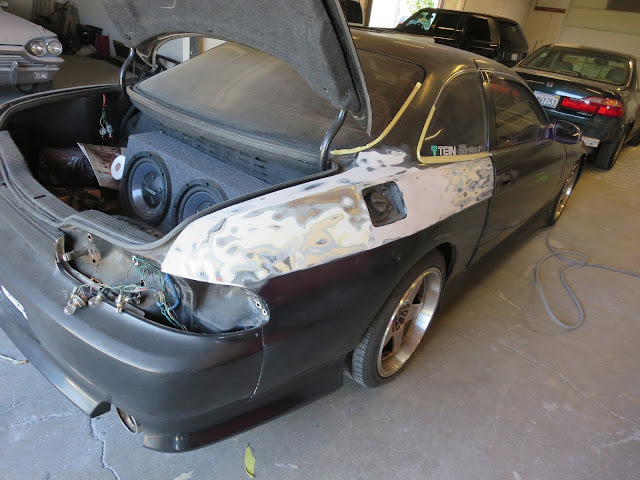 Lexus SC300 in process of repair to old body damage on quarter panel.