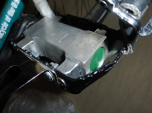 complete bike pedal with bottle cap dust cap on bike