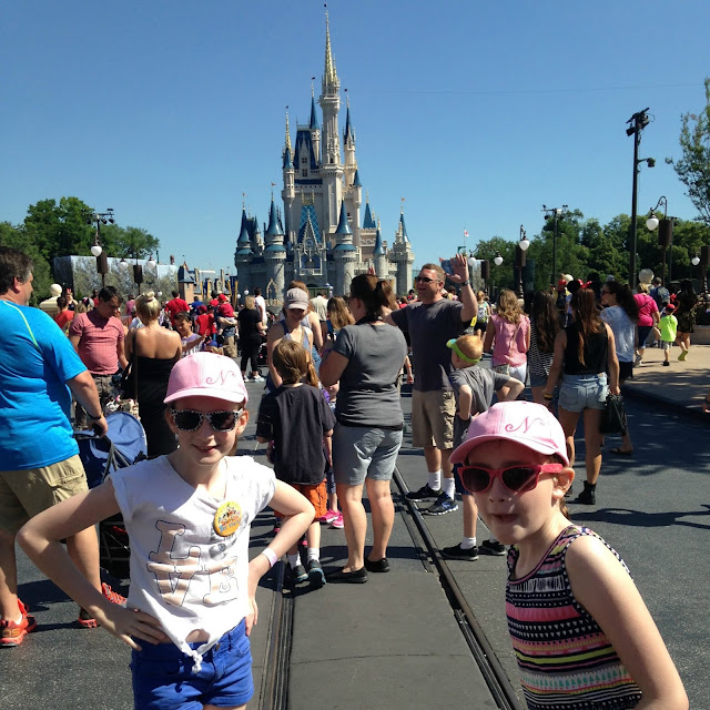 stephstwogirls in front of Disney castle