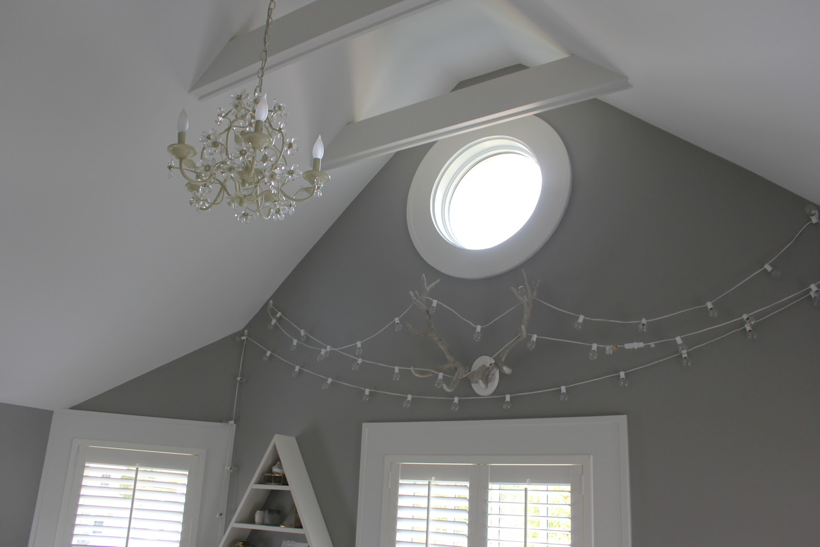 Round window detail in modern farmhouse bedroom on Hello Lovely Studio