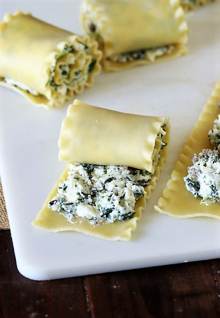Rolling Up Spinach Lasagna Roll-Ups with Sausage Image