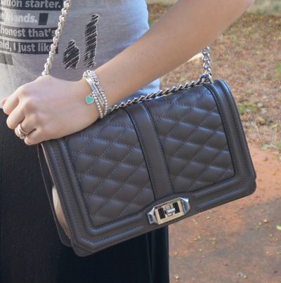 Rebecca Minkoff grey quilted cross body bag with black maxi skirt