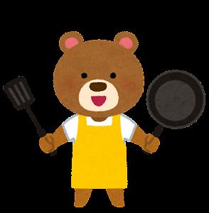 料理をする動物のキャラクター(クマ)