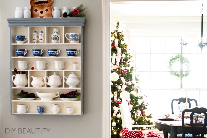 Christmas tree and wall cubby with ironstone collection and jingle bells