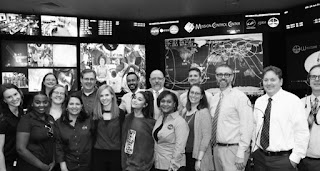 ariana grande nasa officer black and white photo in mission control center