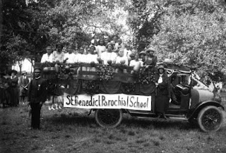 1920s photo of students seated in a truck decorated for a parade