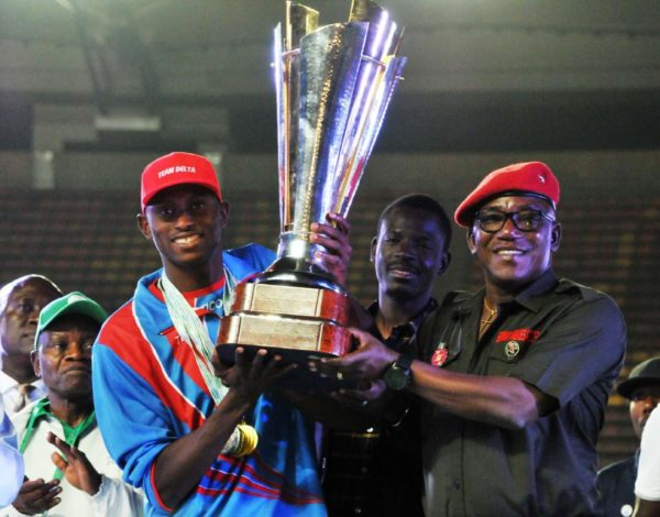 Minister of Sports Dalung presents Team Delta with the first prize trophy at the National Sports Festival