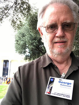 Resident Astronomer picks up badge and coffee and heads to Caltech Beckman Auditorium (Source: Palmia Observatory)