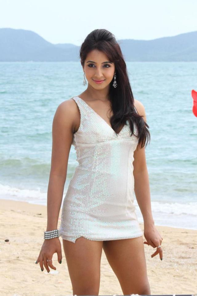 Glamorous Kannada Girl Sanjana White Mini Top Photos In Beach