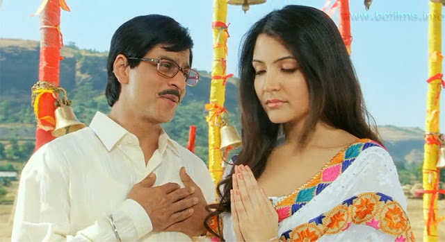 "Rab Ne Bana Di Jodi (2008) is also known as RNBDJ. Rab Ne Bana Di Jodi (2008) is an Indian romantic comedy film directed by Aditya Chopra and produced by Yash Chopra and Aditya Chopra under the banner of Yash Raj Films in 2008. The film is starred by Shahrukh Khan and newcomer Anushka Sharma in the lead roles.   Shahrukh Khan and Anushka Sharma in Rab Ne Bana Di Jodi (2008) movie   ""There is an extraordinary love story in every ordinary Jodi"". ____ Aditya Chopra.     Rab Ne Bana Di Jodi is a romantic, comedy but pathetic love story. I have watched several times it. But when I watch it, I wish I watch it again and again. It is a pathetic romantic love story. If you watch it, I swear that you cannot forget its story or its artistic editing, heart touching soundtracks. Here Shahrkh Khan casts as Surinder Sahni and simultaneously as Raj. Newcomer Anushka Sharma casts as Taani. I know that you all have watched the film, so don't want to share the plot summary. But for the convenience of describing the film, sometimes needs to share the plot story. Surinder takes his bride into the house. Always Taani is upset and feels unhappy in the house. Actually Surinder is the main cause of her unhappiness. She neither loves him nor hopes him. But now she is his wife. In Indian culture, religion, not only India but also most of the countries in the world, marriage is the bonding between two souls, man and woman. Here the word social responsibility comes when a man and a woman get married. Without love the persons spend the whole life because of marriage a bonding or a social responsibly. Never anyone asks that whether she is happy with her new married life or not. If anyone asks, there is no positive outcome. They recommend that all will be good while needed. However, Taani has lost his former future husband, his father. But when no one was beside her for consoling, Surinder came in his life and gave a new life. He only loves her most in the world. But she does not feel his love. Surinder is something less talker, very ordinary and very humble person works at company. Surinder also joins in the dance competition disguising as Raj for knowing the inner words of Taani. Unfortunately, she falls in love of Raj. But what will she do now? In one side his social responsibility, bonding and on the other his love, happiness. Surinder at first sight saw god in her but could not express. But disguising Raj, he shows her the miracle 'I Love You' written in the city with lighting at night. But she has no option that whether she would run away with Raj or not. But actually their love story is matched by God. So, she, in the last moment, left it to God that in which person she sees God. Mr. Surinder Sahani. So, she leaves Raj and tells that she sees god in Surinder Sahni, her husband and she would not run away with Raj. But in the dance completion final round, when Raj did not come, Surinder came and accompanied her. She understood that Surinder told lie that he never could love her. But, how did he love her so much? Actually there is an extraordinary love story in every Dodi.   Shahrukh Khan and Anushka Sharma in Rab Ne Bana Di Jodi (2008) movie   Some songs have been used in the film. But two songs are most popular and most pathetic. One is title song 'Tujh Mein Rab Dikhta Hai' and other is 'Haule Haule' song. I think the best script it is. What a pathetic dialogues and soundtracks which are not forgettable. Heart touching performance both of them is noticeable. In the last half of the film, 'Zero' (2018) Shahrukh Khan and Anushka Sharma's performance was also pathetic though the first half has got many negative reviews. Rab Ne Bana Di Jodi (A Match Made by God) has earned many positive reviews. Actually its overall things are so dramatic, romantic, and pathetic that a watcher never forgets it."
