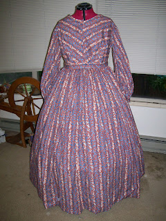 Coral striped dress for 1850s with bishop sleeves.