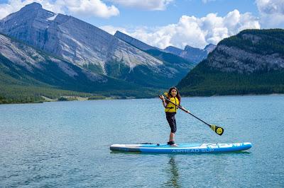 Stand up paddleboarding on Spray Lakes Reservoir, Kananaskis