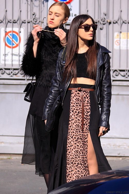 Woman wearing leopard print skirt in the street of Milan. Street style fashion outfit.