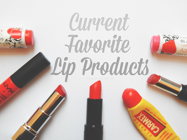 multiple lip products laying on a white background