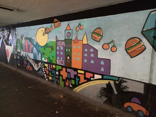 Pac-Man street art by Gorse Hill Studios in Stretford