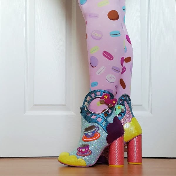 wearing pink macaron printed tights and glitter ankle boots with rollercoaster track detail