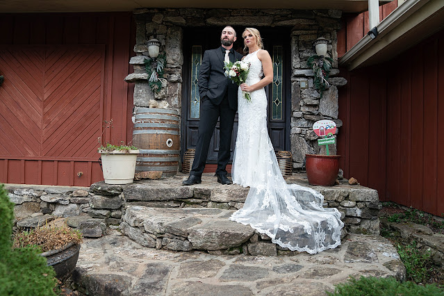 Bride and Groom portrait with wedding dress train drooping down crafted stone staircase Magnolia Farm Asheville Wedding Photography captured by Houghton Photography