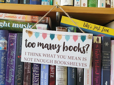 Too Many Books Sign with Bookshelves