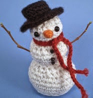 http://www.ravelry.com/patterns/library/frosty-the-snowman---amigurumi-pattern
