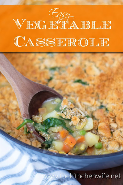A pan of the easy vegan vegetable casserole being scooped out with the title above.
