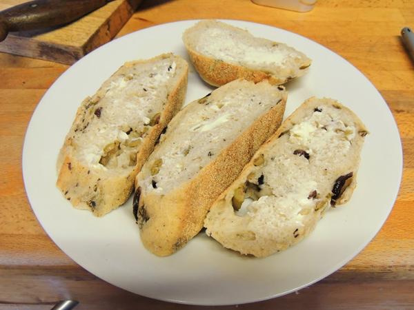 Sliced olive bloomer (bread), buttered