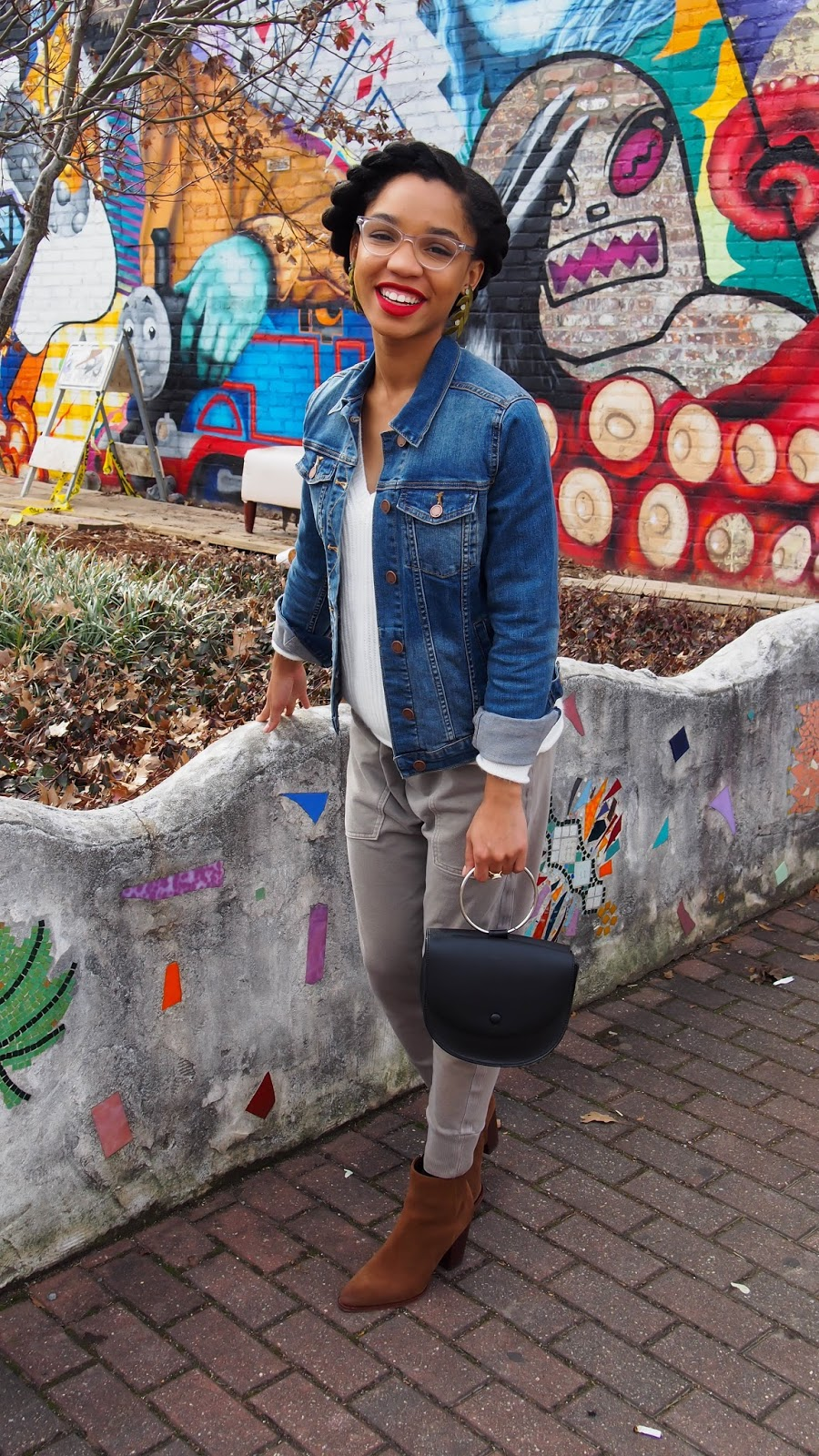 How To Travel In Style Jean Jacket And Joggers The Strong Suit