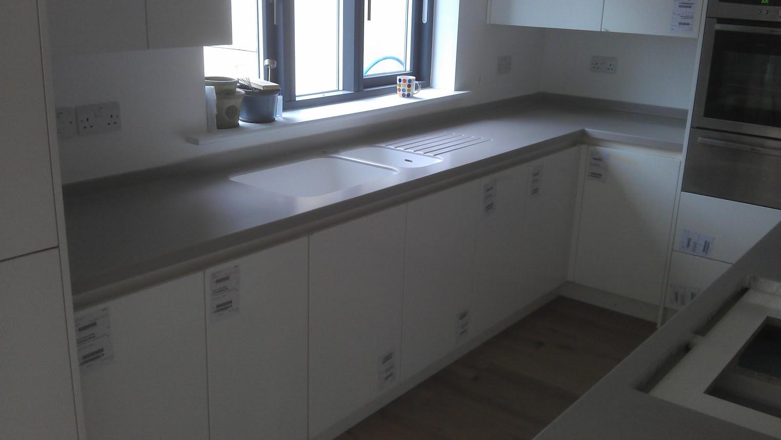 corian kitchen countertops wood cart clay island on white mereway handless ...