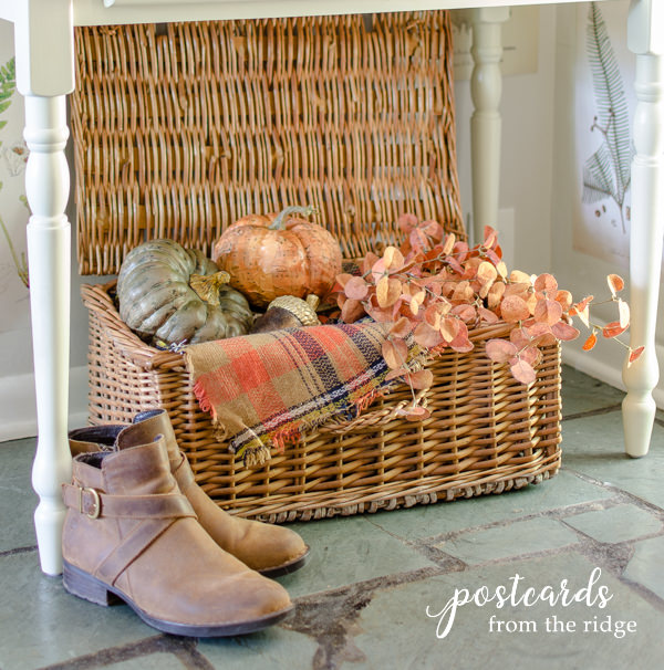 vintage french picnic hamper with fall decor and brown leather booties